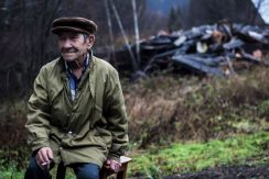 Resident by his burnt-out house in a demolished village in Kuzbass