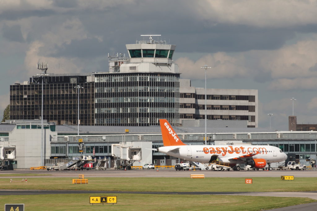 "Manchester Airport plans to grow. ""There should be an escalating tax on frequent fliers,"" says Friends of the Earth campaigner Jenny Bates"